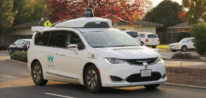 An autonomous Waymo Chrysler Pacifica Hybrid minivan undergoing testing in Los Altos, California
