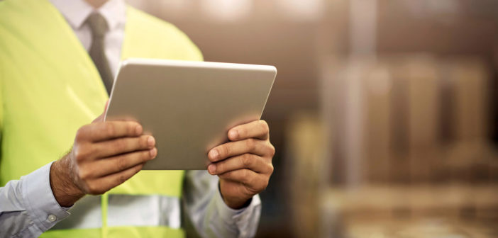 Closeup shot of an unrecognisable man working on a digital tablet in a distribution warehouse